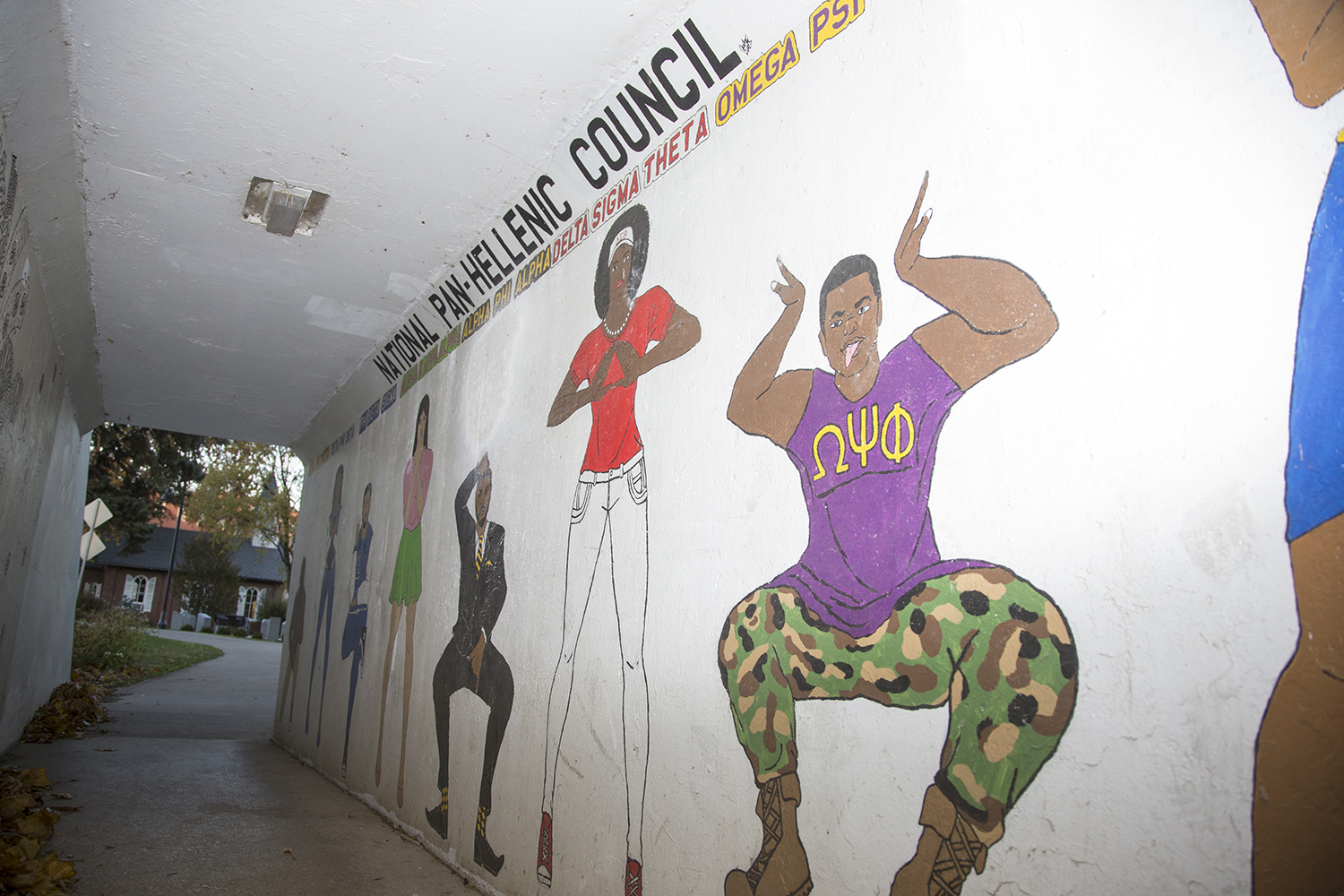The pedestrian mural is seen in the tunnel by Hubbard Park in Iowa City on Sunday, Oct. 28, 2018. The mural will be decommissioned in November.