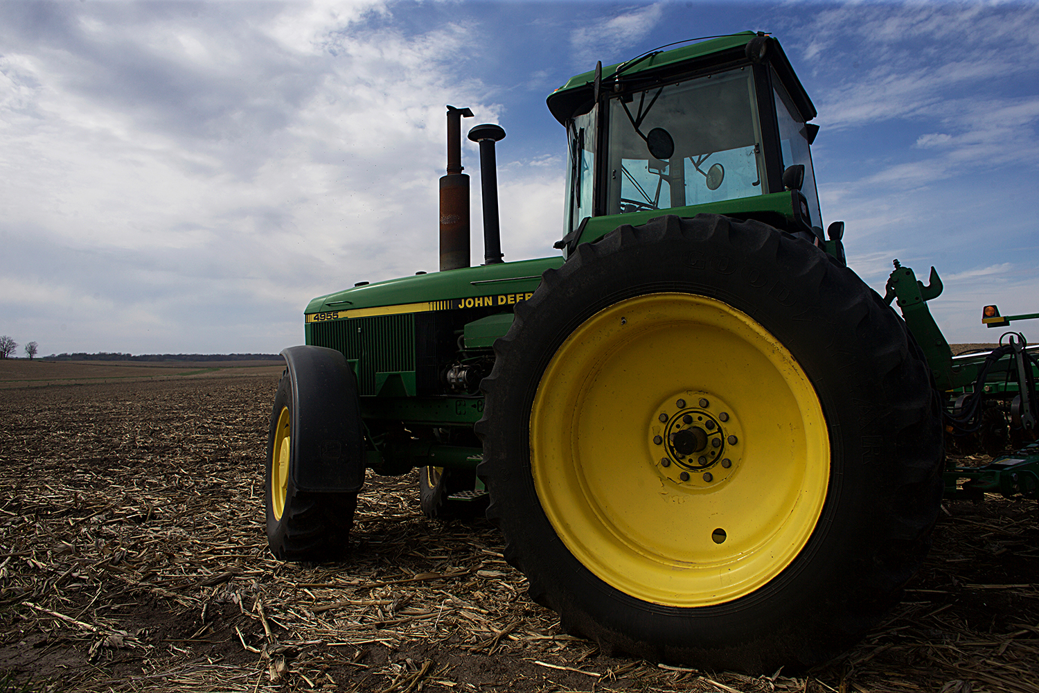 A tractor is parked in a field outside of Iowa City, Iowa on Wednesday, April 15, 2015.