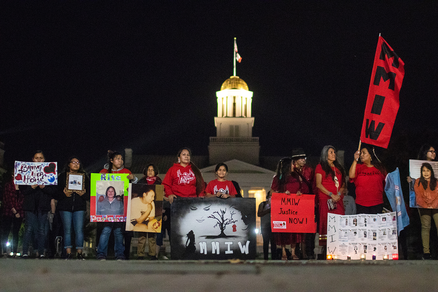 Community members stand in silence during a vigil on the pentacrest on October 8th 2018. The vigil was held in honor of all Missing Murdered Indigenous Women. (Megan Nagorzanski/The Daily Iowan)