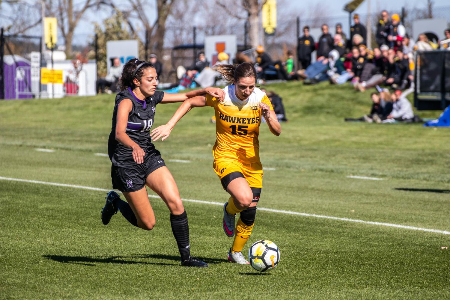 Iowa forward Rose Ripslinger dribbles the ball up the field during Iowa's game against Northwestern on Oct. 21, 2018. Iowa tied Northwestern 1-1.