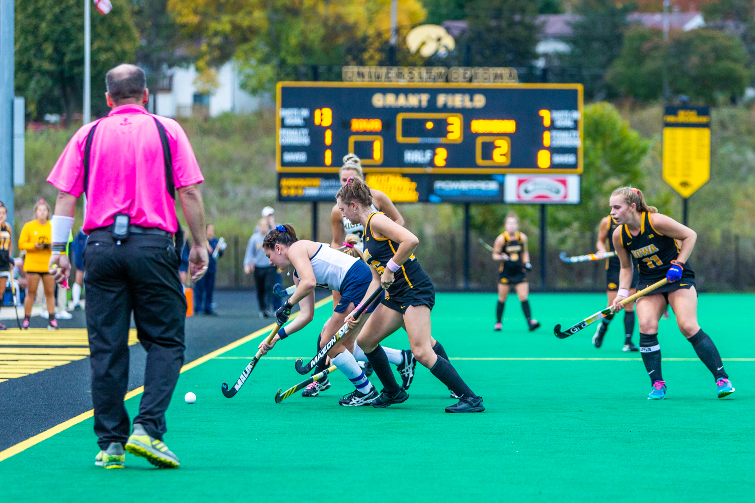 Field hockey players battle for possession as time winds down during a field hockey match between Michigan and Iowa on Friday, Oct. 5, 2018.