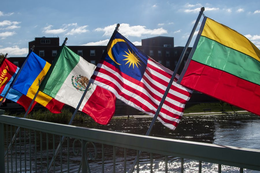 Over+100+flags+are+on+display+on+the+Iowa+Memorial+Union+Pedestrian+Bridge+to+recognize+the+international+students+on+campus.+