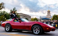 Miss Iowa rides in Corvette in front of Old Cap during the Homecoming Parade on Friday, Oct. 19, 2018. (David Harmantas/The Daily Iowan)