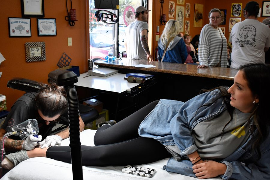 Kinsey Phipps receives a crescent moon tattoo at Velvet Lotus Tattoo shop on Sunday, October 28, 2018. The shop hosted their second annual Halloween charity event called