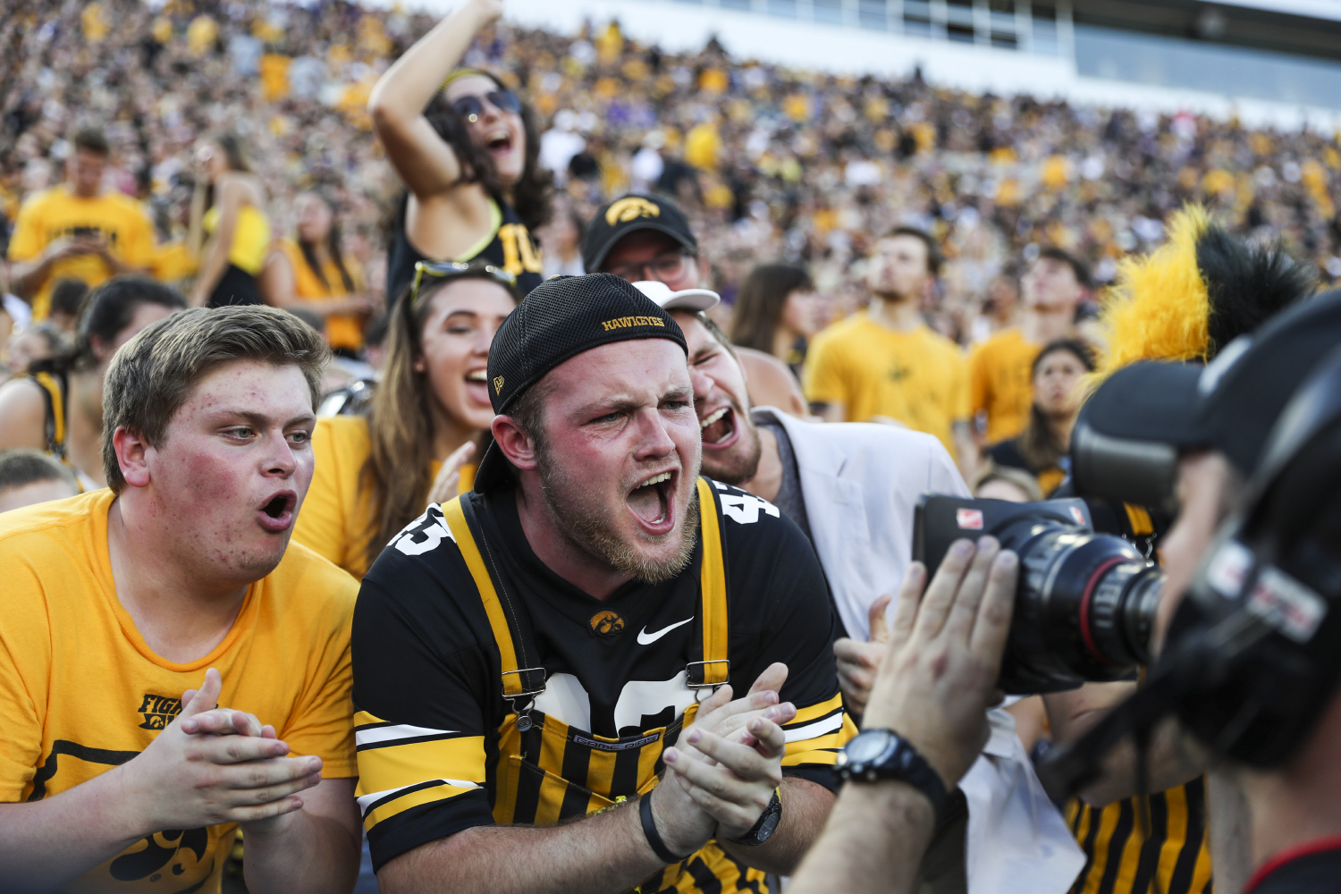 Fans cheer during the Iowa/UNI football game at Kinnick Stadium on Saturday, Sept. 15, 2018.