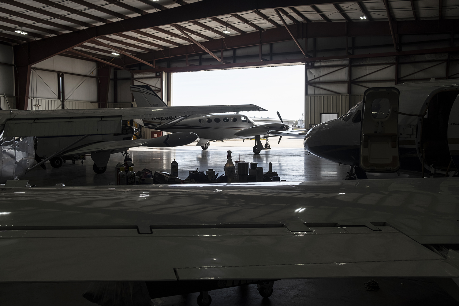 Parked aircraft are seen in a maintenance hanger at the Iowa City Municipal Airport on Wednesday, October 24, 2018.