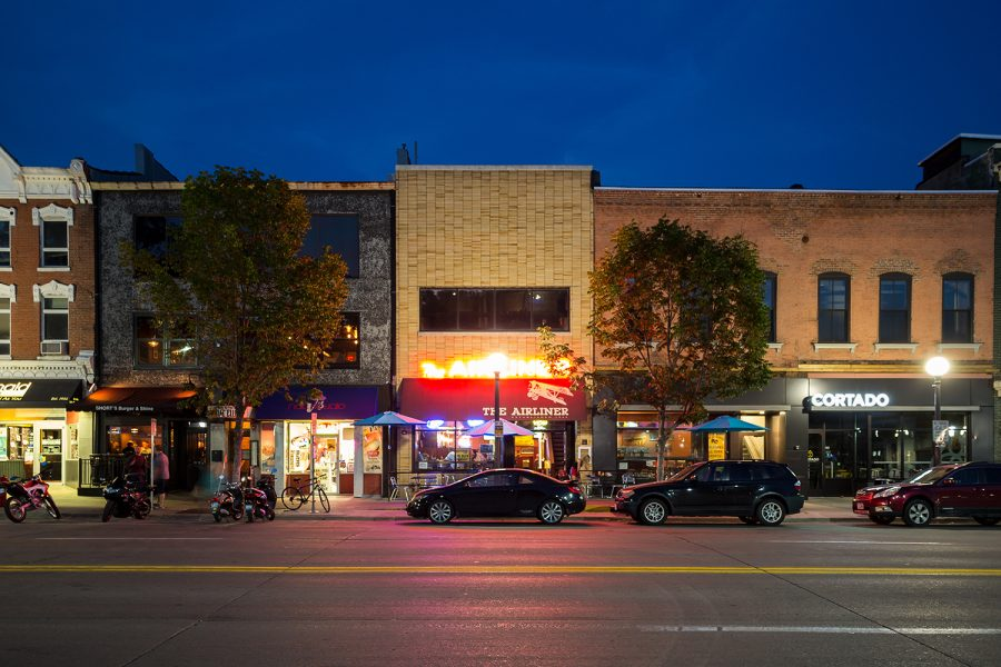 In this composite photo, businesses line Clinton St. in Iowa City on a summer evening. Tuesday, Sept. 12, 2017.