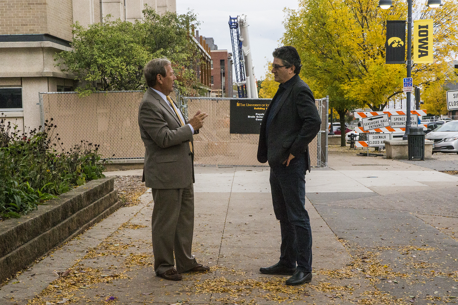 From left: UI President Bruce Harreld and Psychological and Brain Sciences Chair Mark Blumberg speak outside the construction on the new Psychology and Brain Sciences Building on Monday, Oct. 8, 2018. The facility is expected to open in January 2020.