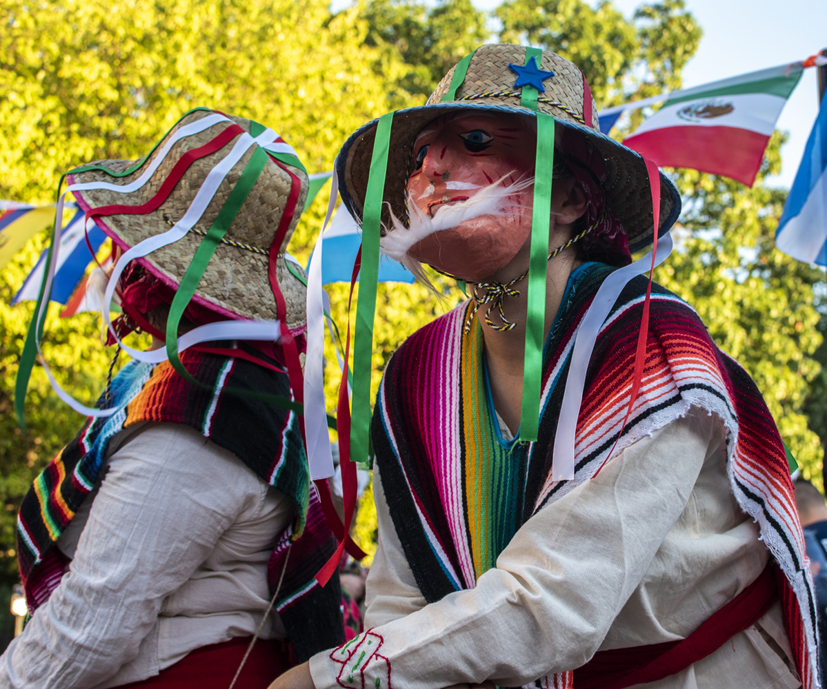 Masked dancers entertain at the annual Latino Festival on Sunday, Sept. 23, 2018. The event took place in front of the Iowa City Senior Center on Linn Street.