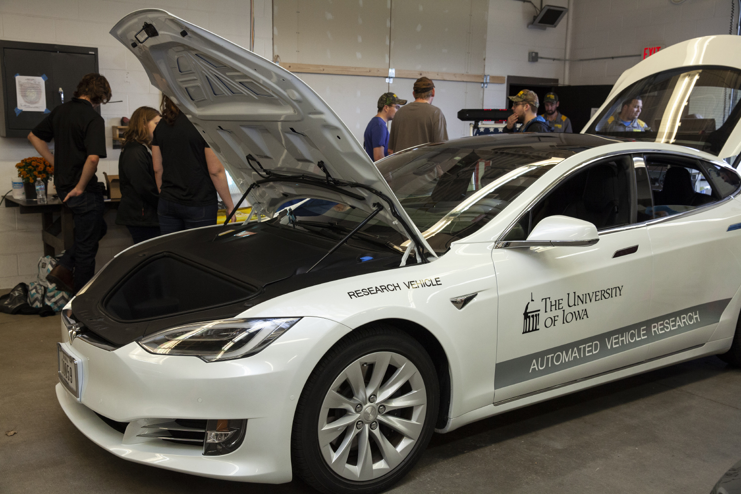 A Tesla automated driving research vehicle sits in a garage on display during an open house at the National Advanced Driving Simulator in Coralville on Wednesday Oct. 10, 2018. (Nick Rohlman/The Daily Iowan)
