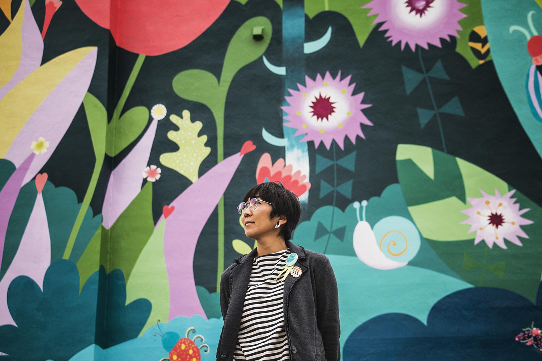 Artist Sayuri Sasaki Hemann stands in front of the