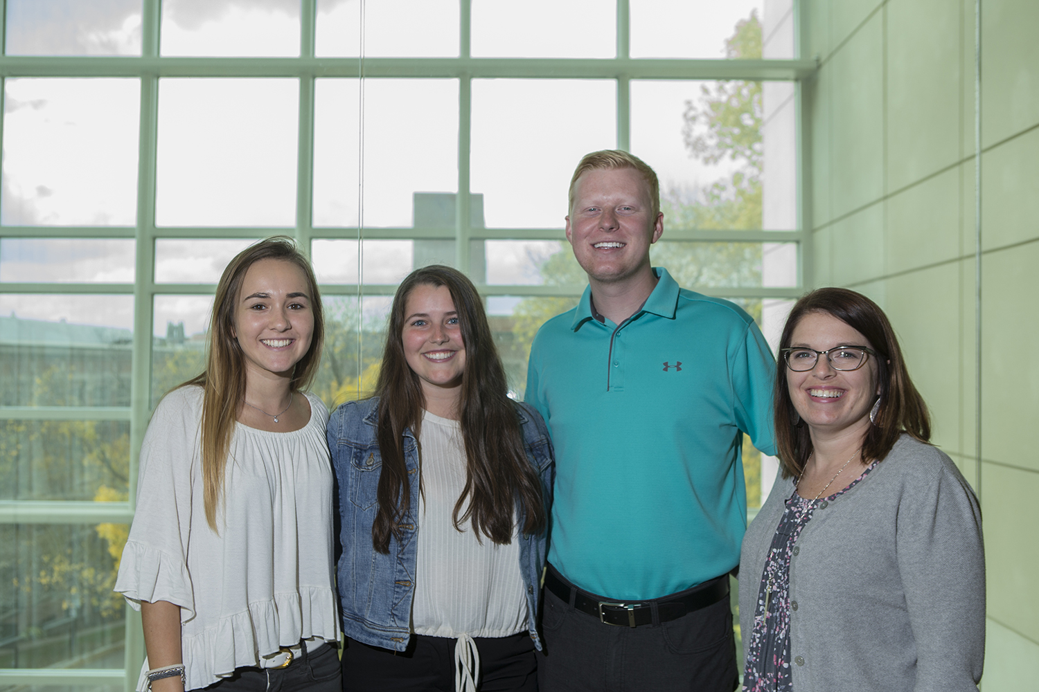 Peer advisors (from left) junior Magdalena Caro, senior Caden Crandall, senior Melanie Taylor, and Senior Director of Operations for the Pomeranz Career Center Angi McKie pose for a portrait in the Pomeranz Center on Oct. 9, 2018. The Pomeranz Career Center helps students work on their resumes, network within their fields, and plan a career path for after graduation.