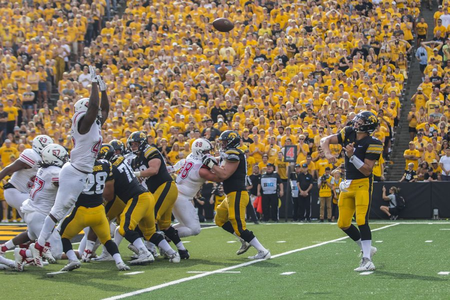 Iowa+quarterback+Nate+Stanley+throws+a+touchdown+pass+during+the+Iowa%2FNIU+football+game+at+Kinnick+Stadium+on+Saturday%2C+Sept.+1%2C+2018.+The+Hawkeyes+defeated+the+Huskies%2C+33-7.+