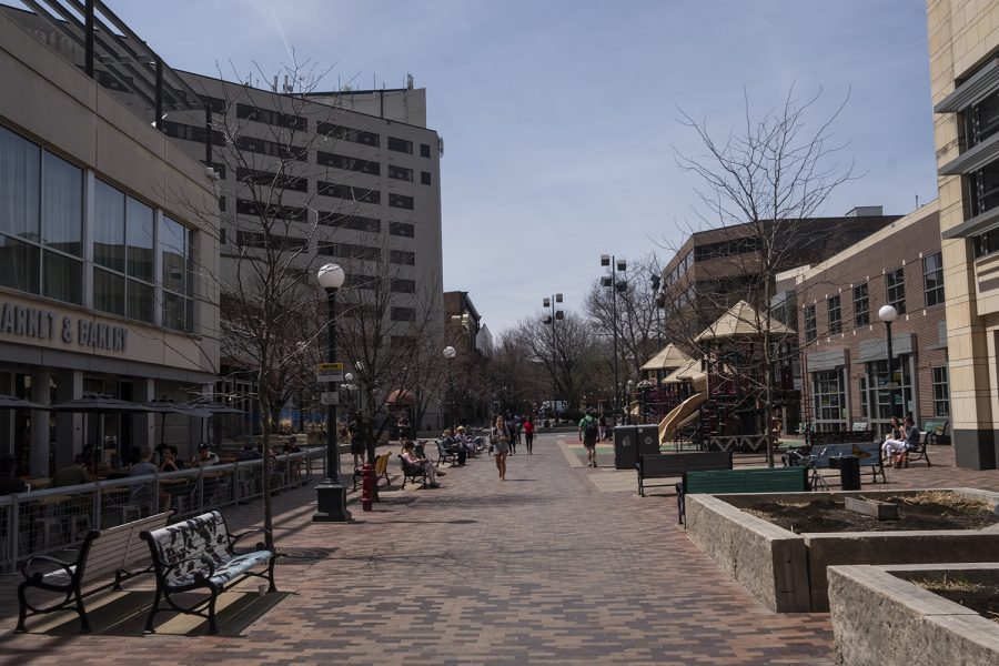 People walk in the Iowa City Pedestrian Mall on Thursday, April 26, 2018. Iowa City has released plans for renovations and updates to the area.