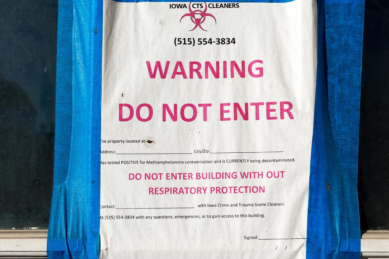 A sign on an apartment building in Washington, Iowa undergoing decontamination methamphetamine contamination on Nov. 19, 2017.
