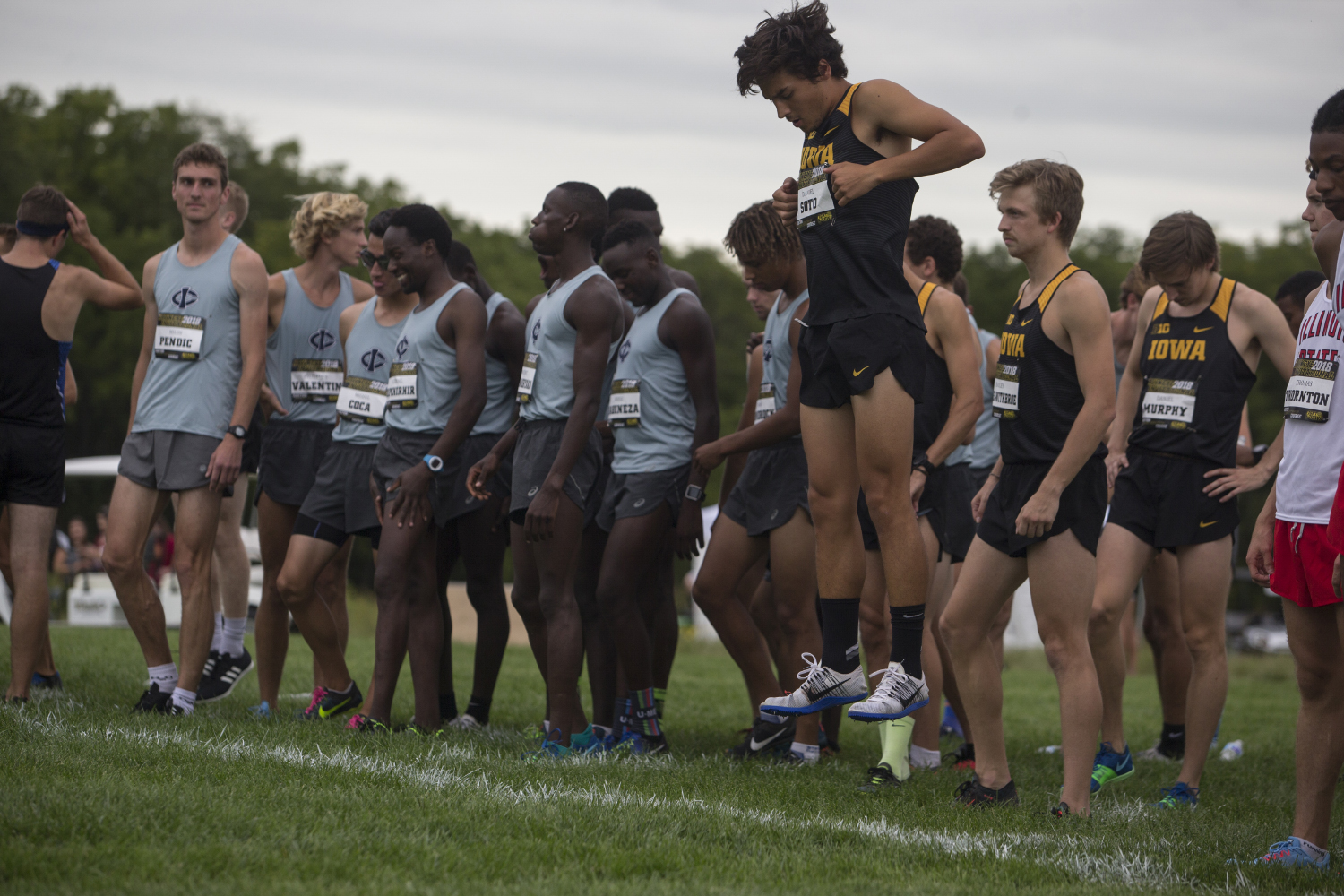 Senior Daniel Soto warms up before the Hawkeye Invitational at Ashton Cross Country course on Friday, Aug. 31, 2018.