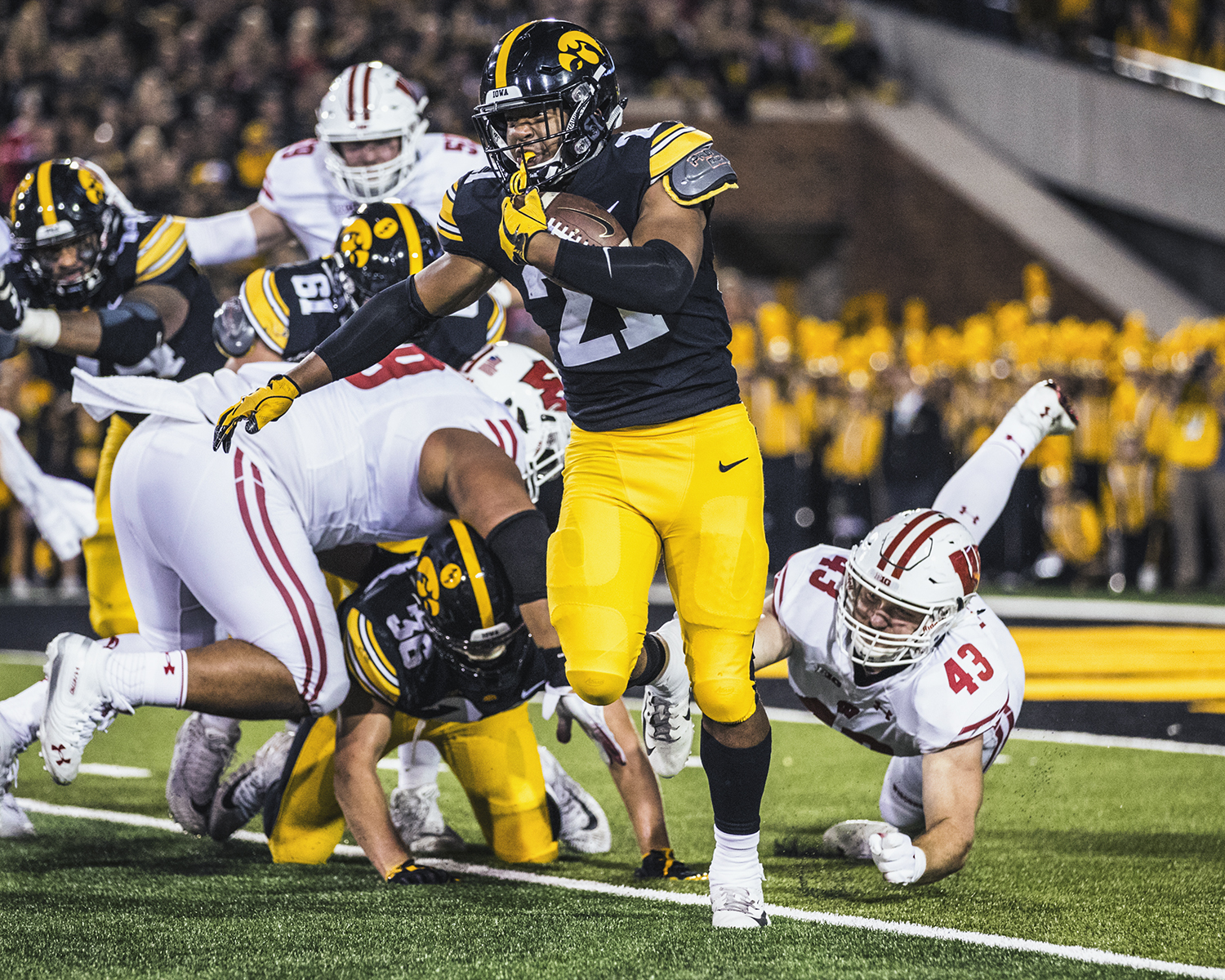 Iowa running back Ivory Kelly-Marthin carries the ball during Iowa's game against Wisconsin at Kinnick Stadium on Saturday, September 22, 2018. The Badgers defeated the Hawkeyes 28-17.