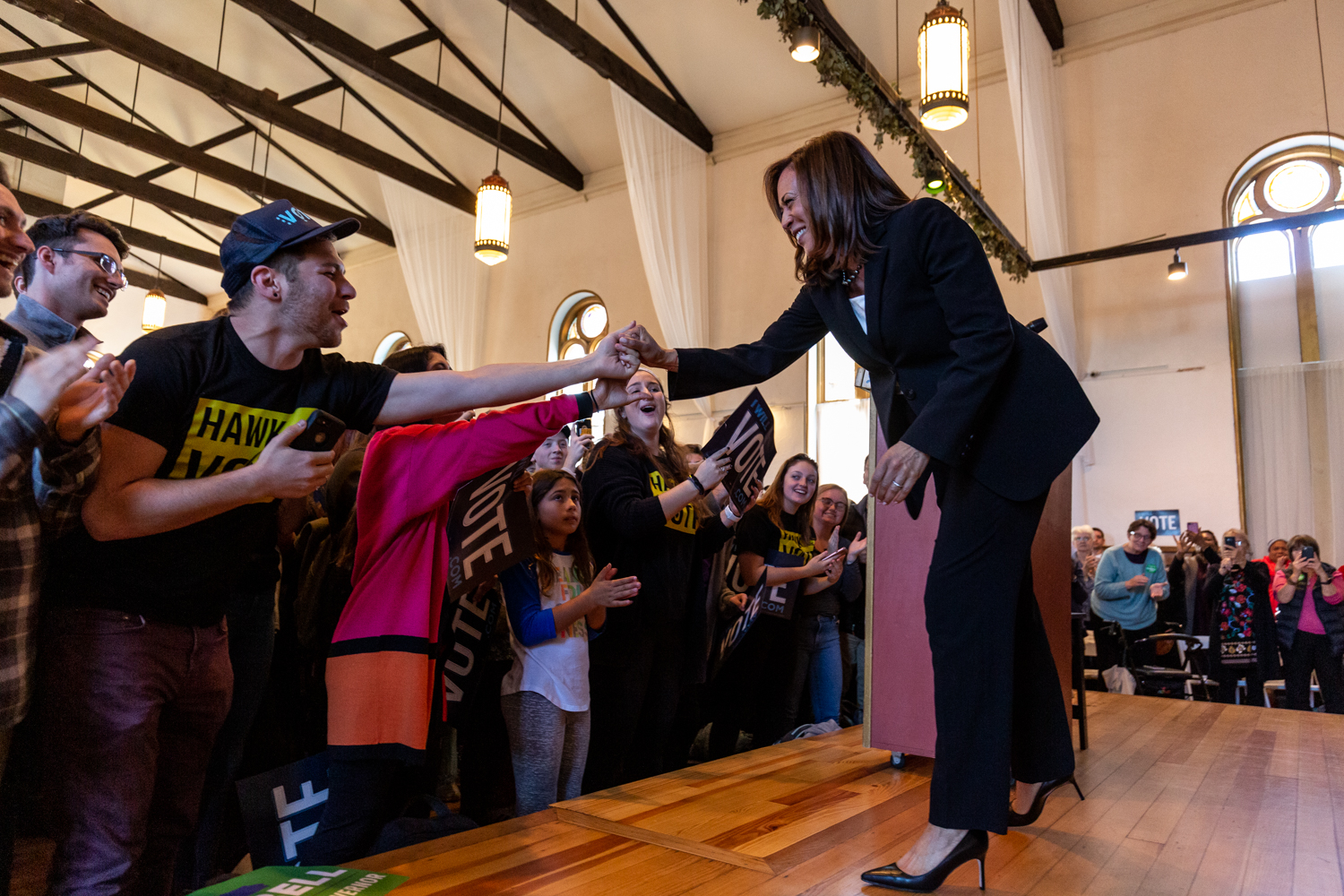 Sen. Kamala Harris (D-Calif.) shakes hands with an attendee at a rally at Old Brick in Iowa City on Tuesday, Oct. 23, 2018