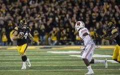 Iowa's Nick Easley evades the defense during a football game between Iowa and Wisconsin on Saturday, Sept. 22, 2018. The Badgers defeated the Hawkeyes, 28-17.