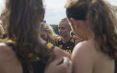 Senior Andrea Shine gives a pep talk before the Hawkeye Invitational at Ashton Cross Country course on Friday, August 31, 2018. The Hawkeyes were defeated by Iowa State 24-56. Andrea Shine placed first in the Women's 4K with a time of 14:07.5.