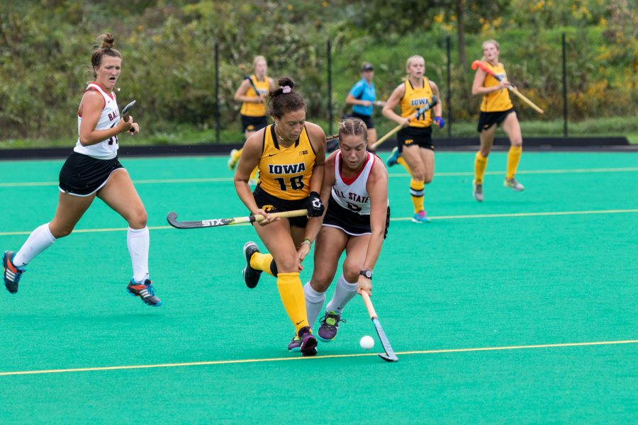 Iowa's Mya Christopher fights for control of the ball during a game against Ball State on Sunday, Sep. 2, 2018. The Hawkeyes defeated the Cardinals 7–1.