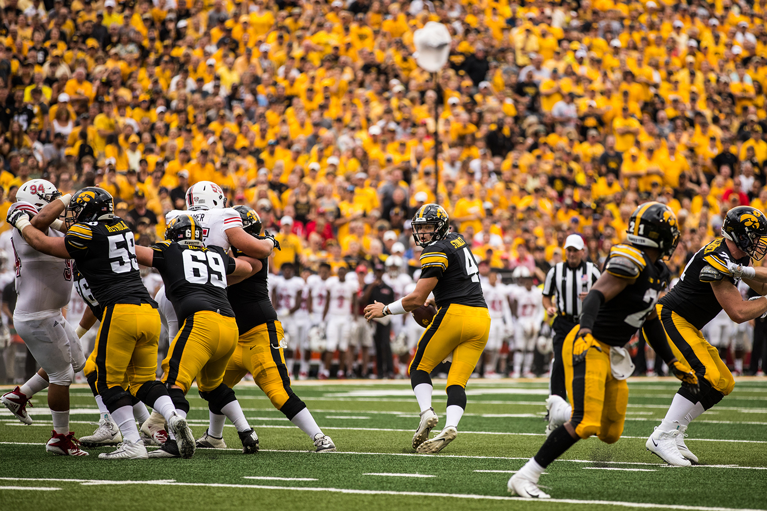 Iowa quarterback Nate Stanley drops back during Iowa's game against Northern Illinois at Kinnick Stadium on Saturday, September 1, 2018. during Iowa's game against Northern Illinois at Kinnick Stadium on Saturday, September 1, 2018. The Hawkeyes defeated the Huskies 33-7.