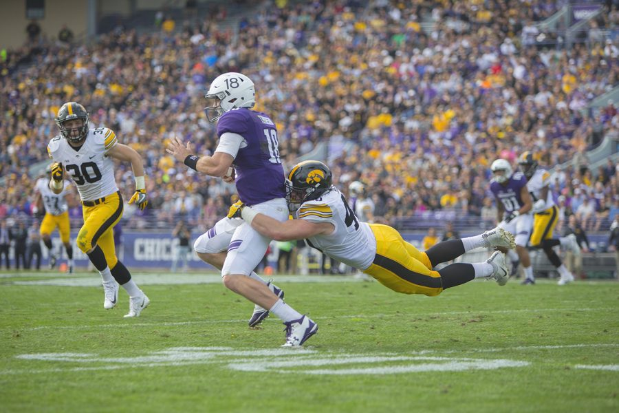 Iowa+defensive+end+Parker+Hesse+tackles+Northwestern+quarterback+Clayton+Thorson+during+the+game+between+Iowa+and+Northwestern+at+Ryan+Field+in+Evanston+on+Saturday%2C+Oct.+21%2C+2017.