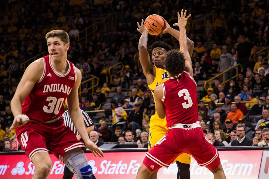 Iowa+forward+Tyler+Cook+looks+to+pass+the+ball+against+Indiana+University+at+Carver-Hawkeye+Arena+on+Saturday%2C+Feb.+17%2C+2018.+The+Hoosiers+defeated+the+Hawkeyes+84+to+82.+