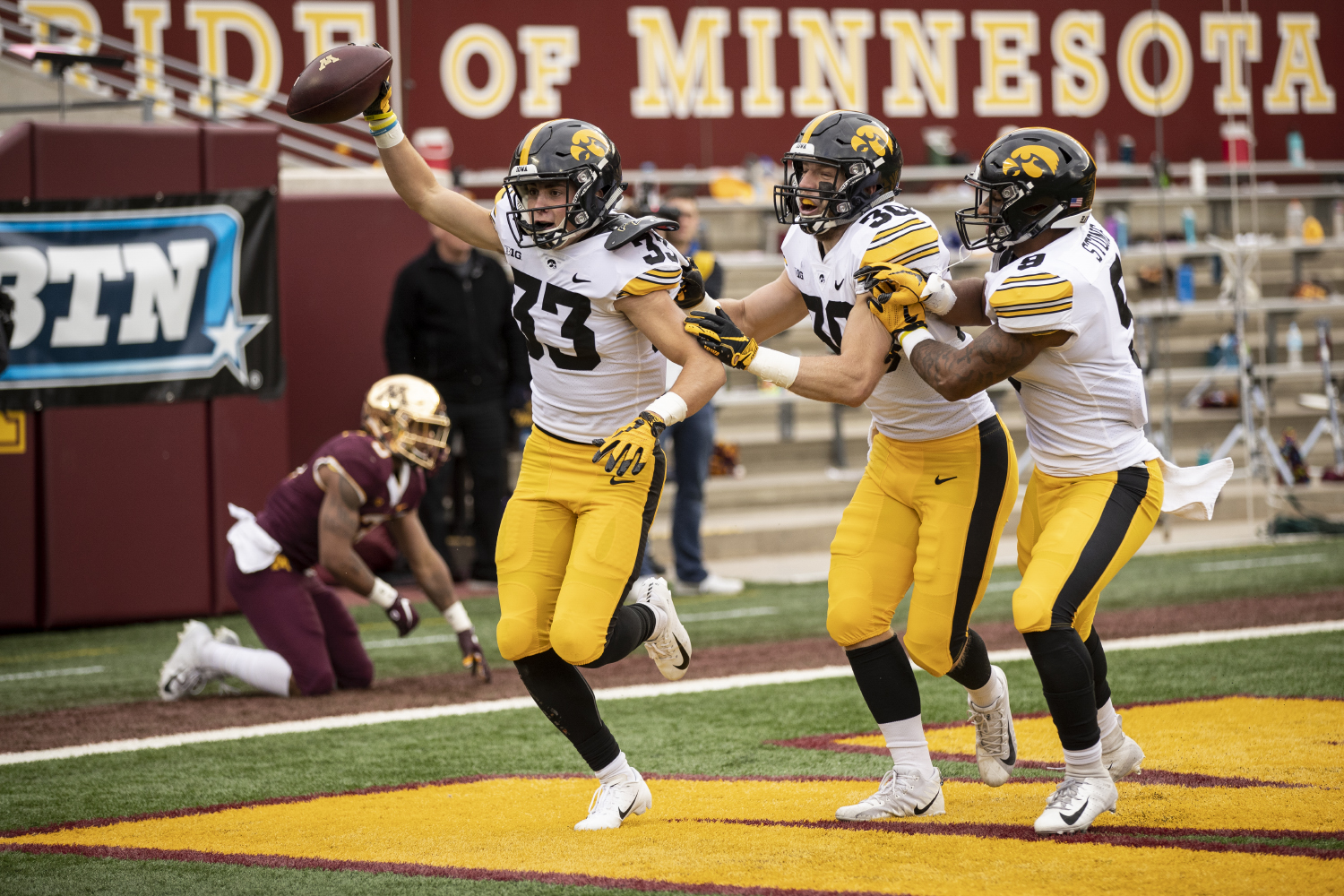 Iowa cornerback Riley Moss (33) celebrates an interception with teammates Jake Gervase (30) and Geno Stone (8) during Iowa's game against Minnesota at TCF Bank Stadium on Saturday, Oct. 6, 2018. The Hawkeyes defeated the Golden Gophers 48-31.