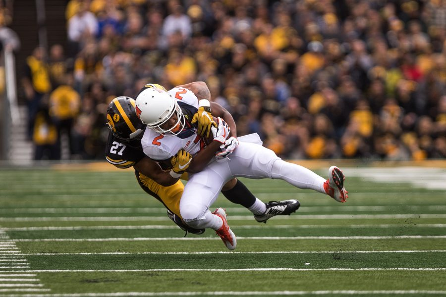 Iowa+defensive+back+Amani+Hooker+tackles+Illinois%27+running+back+Reggie+Corbin+in+the+second+quarter+of+the+Iowa%2FIllinois+football+game+on+Saturday%2C+Oct.+7%2C+2017.