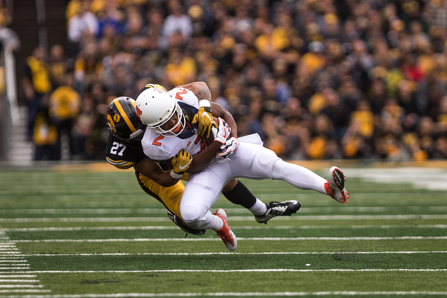 Iowa defensive back Amani Hooker tackles Illinois' running back Reggie Corbin in the second quarter of the Iowa/Illinois football game on Saturday, Oct. 7, 2017.