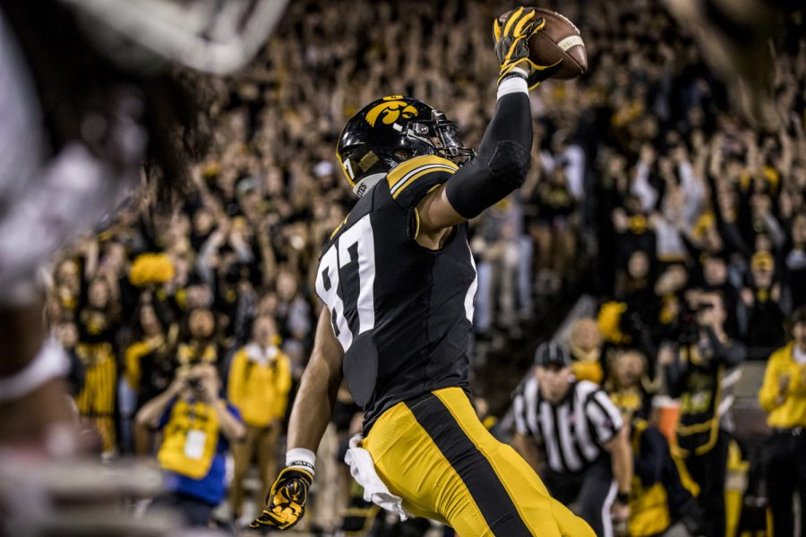Iowa tight end Noah Fant celebrates scoring a touchdown during Iowa's game against Wisconsin at Kinnick Stadium on Saturday, Sept. 22, 2018. The Badgers defeated the Hawkeyes 28-17.