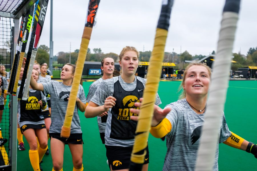 Iowa+field+hockey+players+grab+their+sticks+before+a+field+hockey+match+against+Maryland+on+Sunday%2C+Oct.+14%2C+2018.+The+No.+2+ranked+Terrapins+defeated+the+No.+8+ranked+Hawkeyes+2-1.+