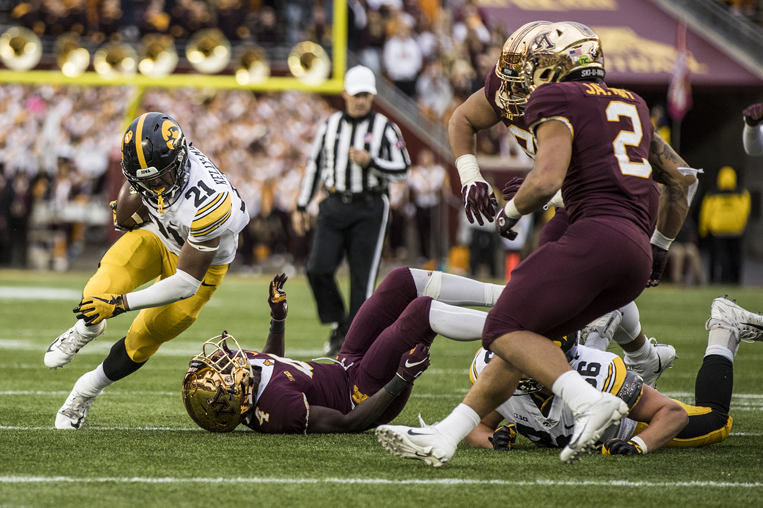 Iowa running back Ivory Kelly-Martin carries the ball during Iowa's game against Minnesota at TCF Bank Stadium on Saturday, October 6, 2018. The Hawkeyes defeated the Golden Gophers 48-31.