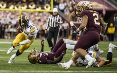 Iowa running back Ivory Kelly-Martin carries the ball during Iowa's game against Minnesota at TCF Bank Stadium on Saturday, Oct. 6, 2018. The Hawkeyes defeated the Golden Gophers 48-31.