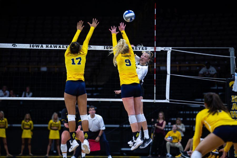 Cali+Hoye+spikes+the+ball+during+Iowa%27s+match+against+Michigan+at+Carver-Hawkeye+Arena+on+September+23%2C+2018.+The+Hawkeyes+were+defeated+3-1.+%28Megan+Nagorzanski%2FThe+Daily+Iowan%29