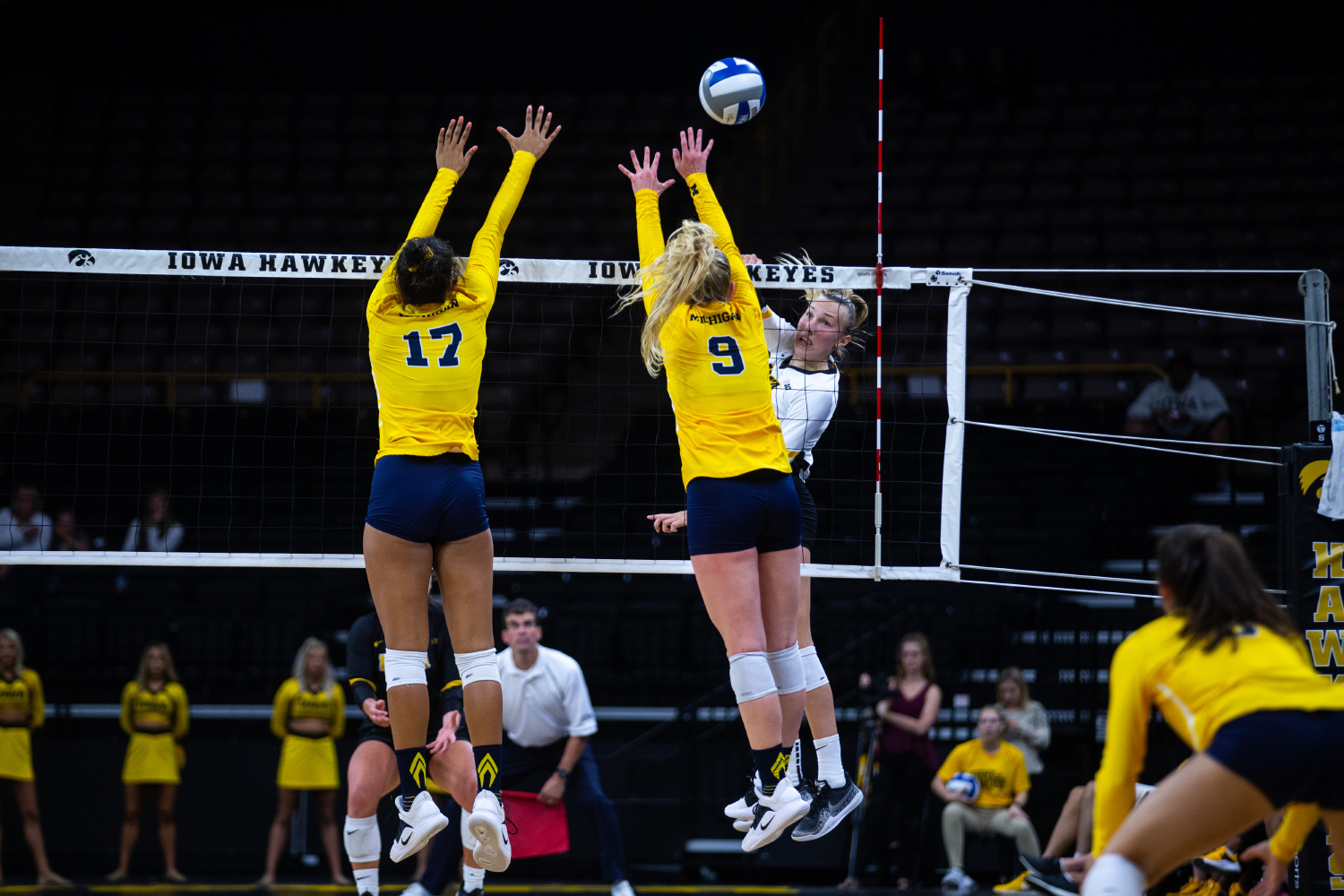 Cali Hoye spikes the ball during Iowa's match against Michigan at Carver-Hawkeye Arena on September 23, 2018. The Hawkeyes were defeated 3-1. (Megan Nagorzanski/The Daily Iowan)