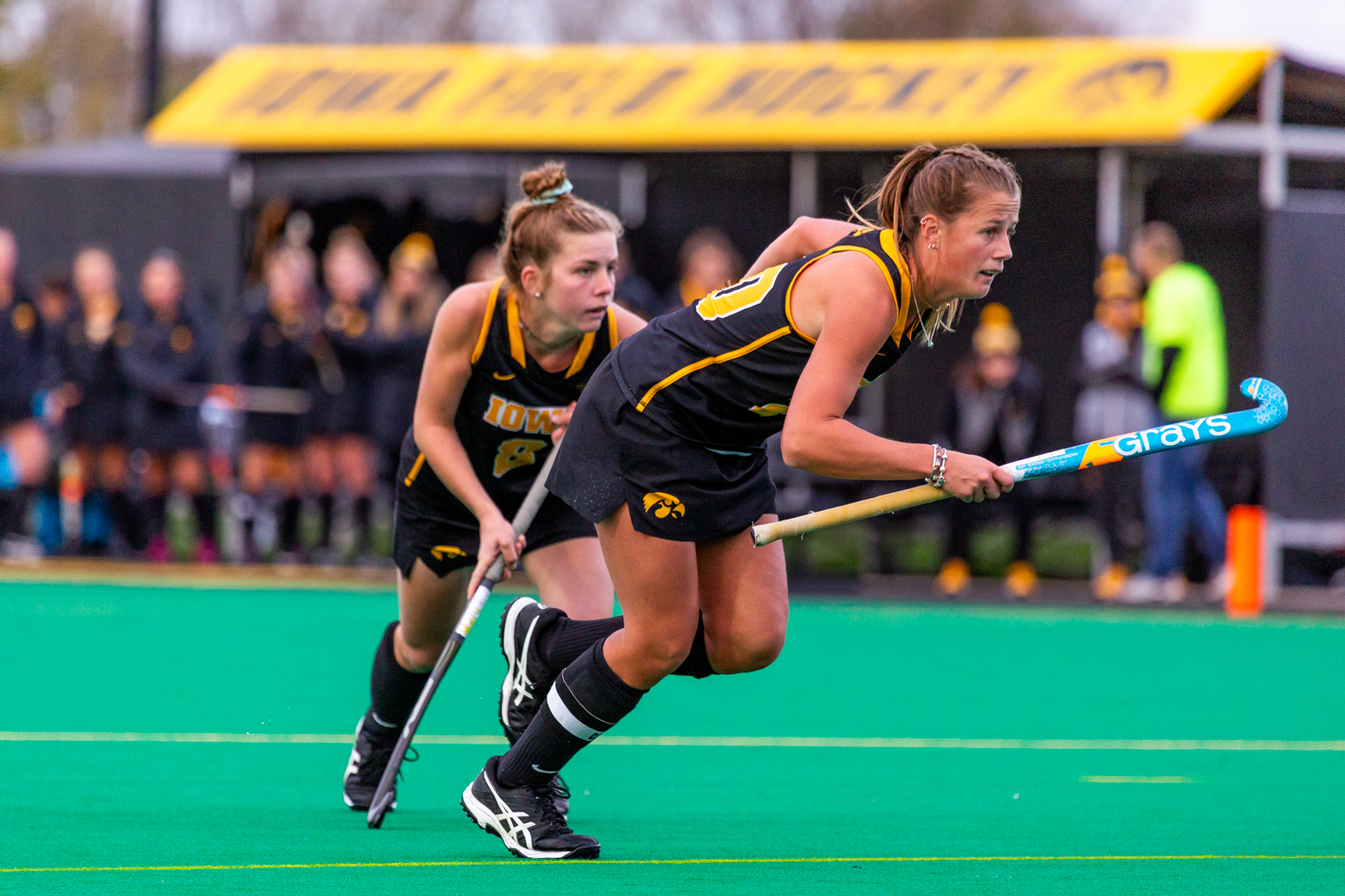 Iowa midfielder Nikki Freeman and Iowa midfielder Sophie Sunderland sprint off their line during a penally corner during a field hockey match against Penn State on Friday, Oct. 12, 2018. The No. 8 ranked Hawkeyes defeated the No. 6 ranked Nittany Lions 3-2.