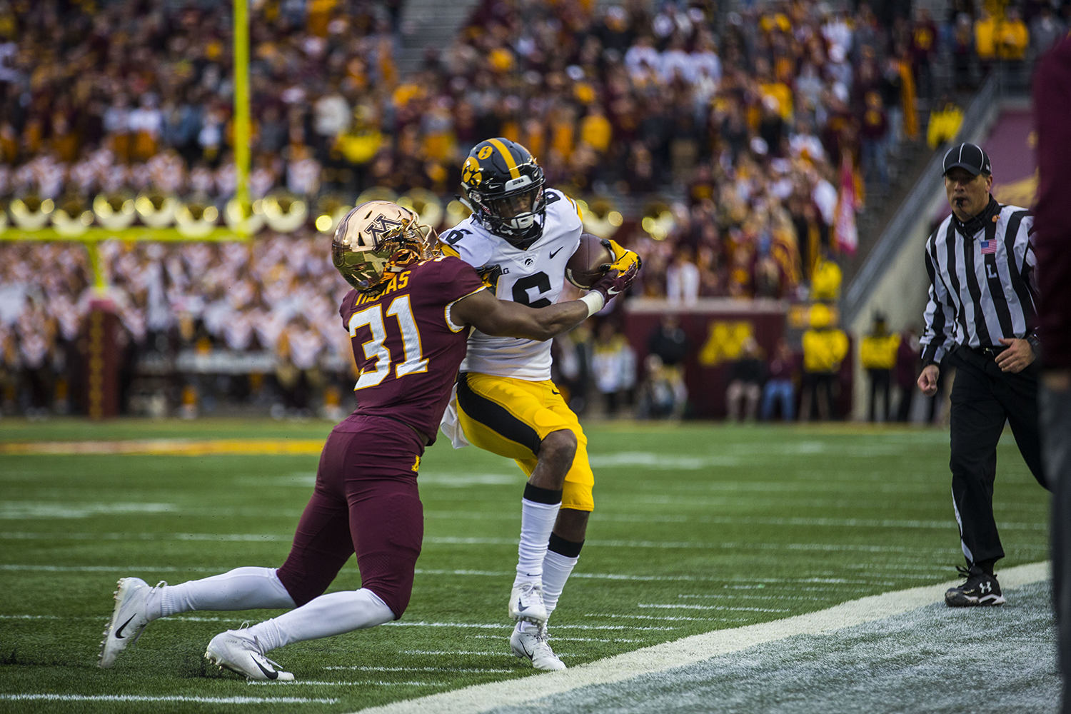 Iowa%27s+Ihmir+Smith-Marsette+attempts+to+shed+Minnesota%27s+Aaron+Mends%27+tackle+during+the+Iowa%2FMinnesota+football+game+at+TCF+Bank+Stadium+in+Minneapolis+on+Saturday%2C+October+6%2C+2018.+The+Hawkeyes+defeated+the+Golden+Gophers%2C+48-31.+