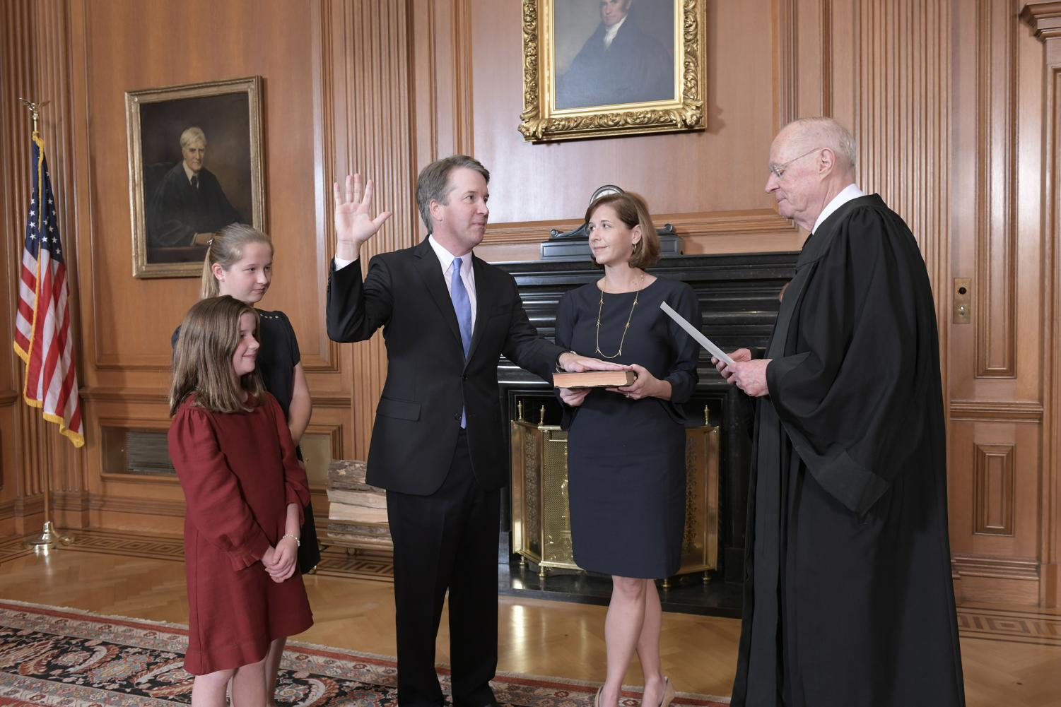 Retired Justice Anthony M. Kennedy administers the Judicial Oath to Judge Brett M. Kavanaugh in the Justices' Conference Room at the Supreme Court Building on Oct. 6, 2018 in Washington, D.C. Mrs. Ashley Kavanaugh holds the Bible. (Fred Schilling/Sipa USA/TNS)