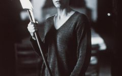Jamie Lee Curtis holds an ax during a scene from her film