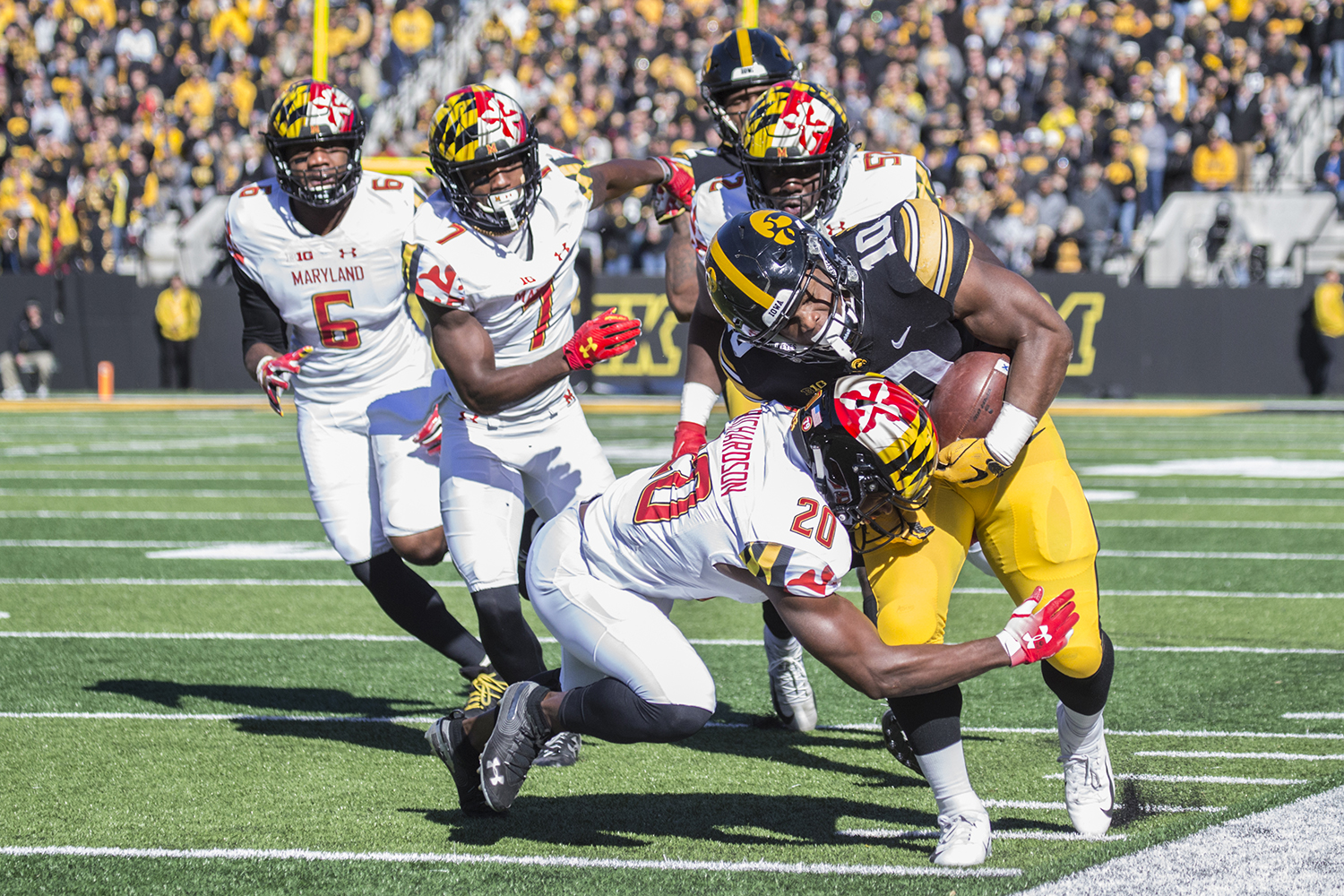 Iowa running back Mekhi Sargent gets tackled on the sideline during a football game between Iowa and Maryland in Kinnick Stadium on Saturday, Oct. 20, 2018. The Hawkeyes defeated the Terrapins, 23-0.