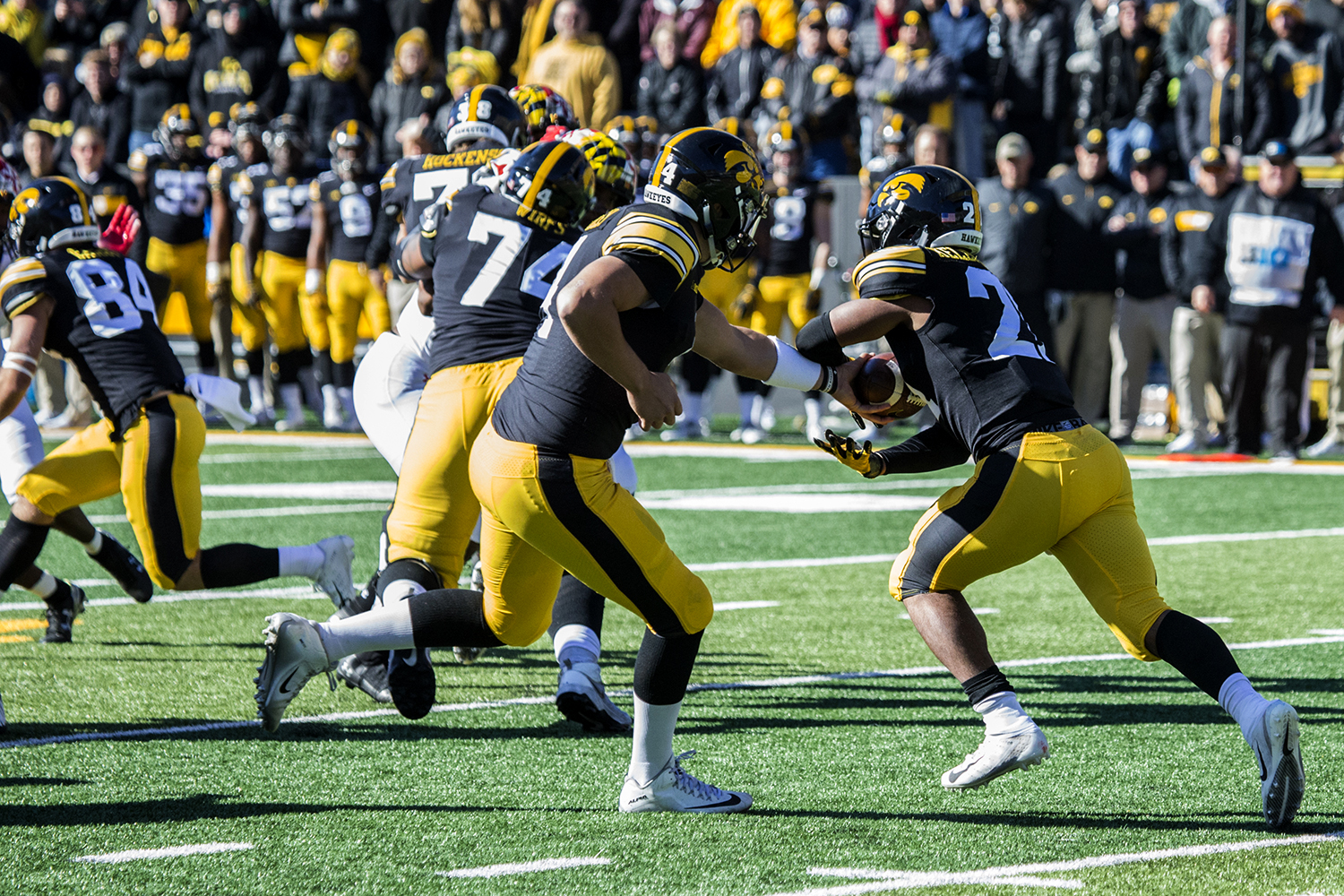 Iowa quarterback Nate Stanley hands the ball off to running back Ivory Kelley-Martin during a football game between Iowa and Maryland in Kinnick Stadium on Saturday, October 20, 2018. The Hawkeyes defeated the Terrapins, 23-0.
