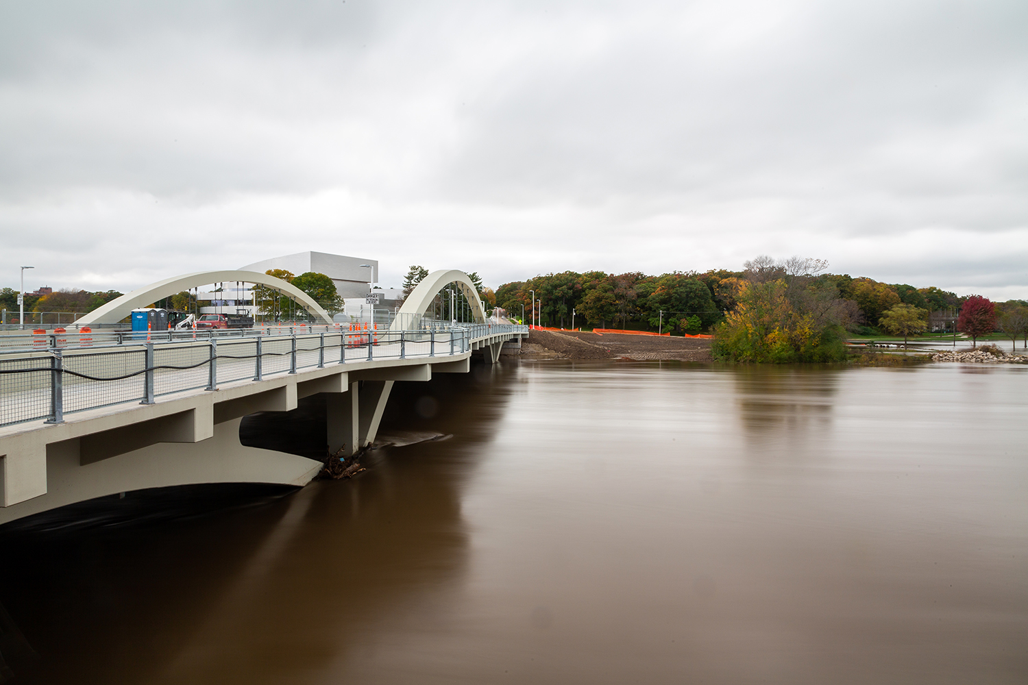 The rain-swollen Iowa river flows by the new Park Rd. Bridge and Dubuque St on Wednesday, Oct. 10, 2018.
