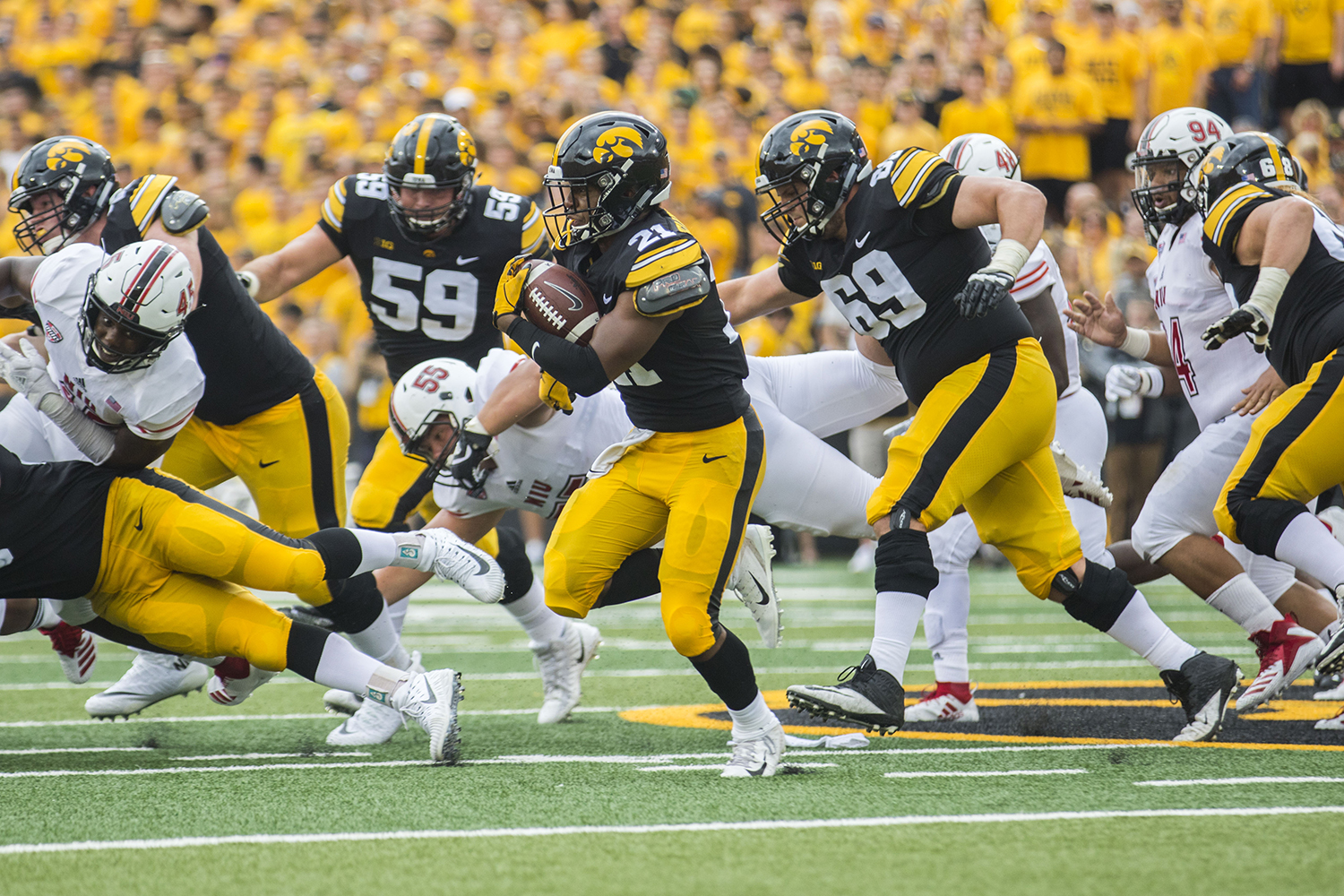 Iowa running back Ivory Kelly-Martin runs with the ball during the Iowa/NIU football game at Kinnick Stadium on Saturday, Sept. 1, 2018. The Hawkeyes defeated the Huskies, 33-7.
