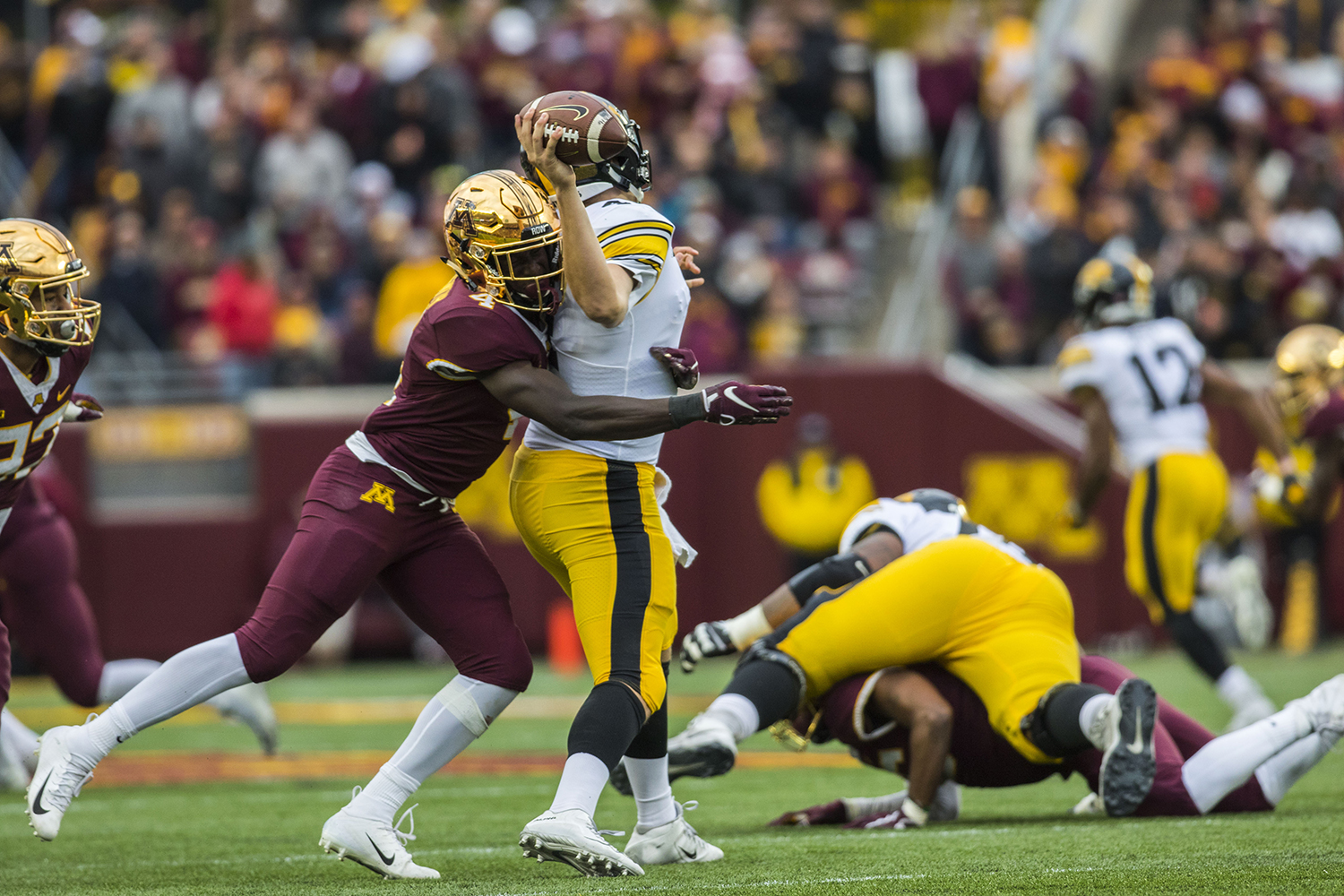 Iowa+quarterback+Nate+Stanley+is+sacked+during+the+Iowa%2FMinnesota+football+game+at+TCF+Bank+Stadium+in+Minneapolis+on+Saturday%2C+October+6%2C+2018.+The+Hawkeyes+defeated+the+Golden+Gophers%2C+48-31.+