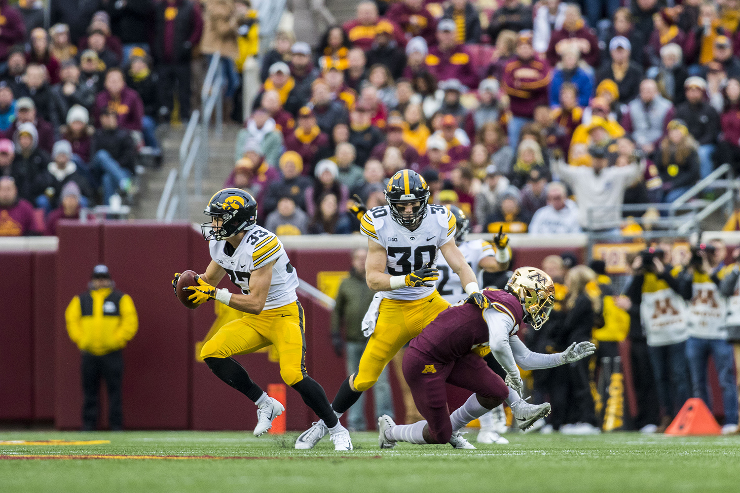 Iowa%27s+Riley+Moss+%2833%29+runs+with+an+interception+he+caught+during+the+Iowa%2FMinnesota+football+game+at+TCF+Bank+Stadium+in+Minneapolis+on+Saturday%2C+October+6%2C+2018.+The+Hawkeyes+defeated+the+Golden+Gophers%2C+48-31.+