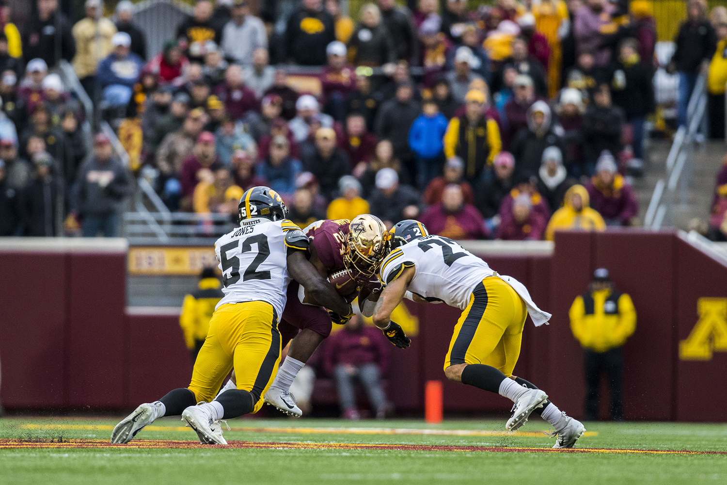 Iowa%27s+Amani+Jones+%2852%29+Amani+Hooker+%2827%29+tackle+Mohamad+Ibrahim+%2824%29+during+the+Iowa%2FMinnesota+football+game+at+TCF+Bank+Stadium+in+Minneapolis+on+Saturday%2C+October+6%2C+2018.+The+Hawkeyes+defeated+the+Golden+Gophers%2C+48-31.+