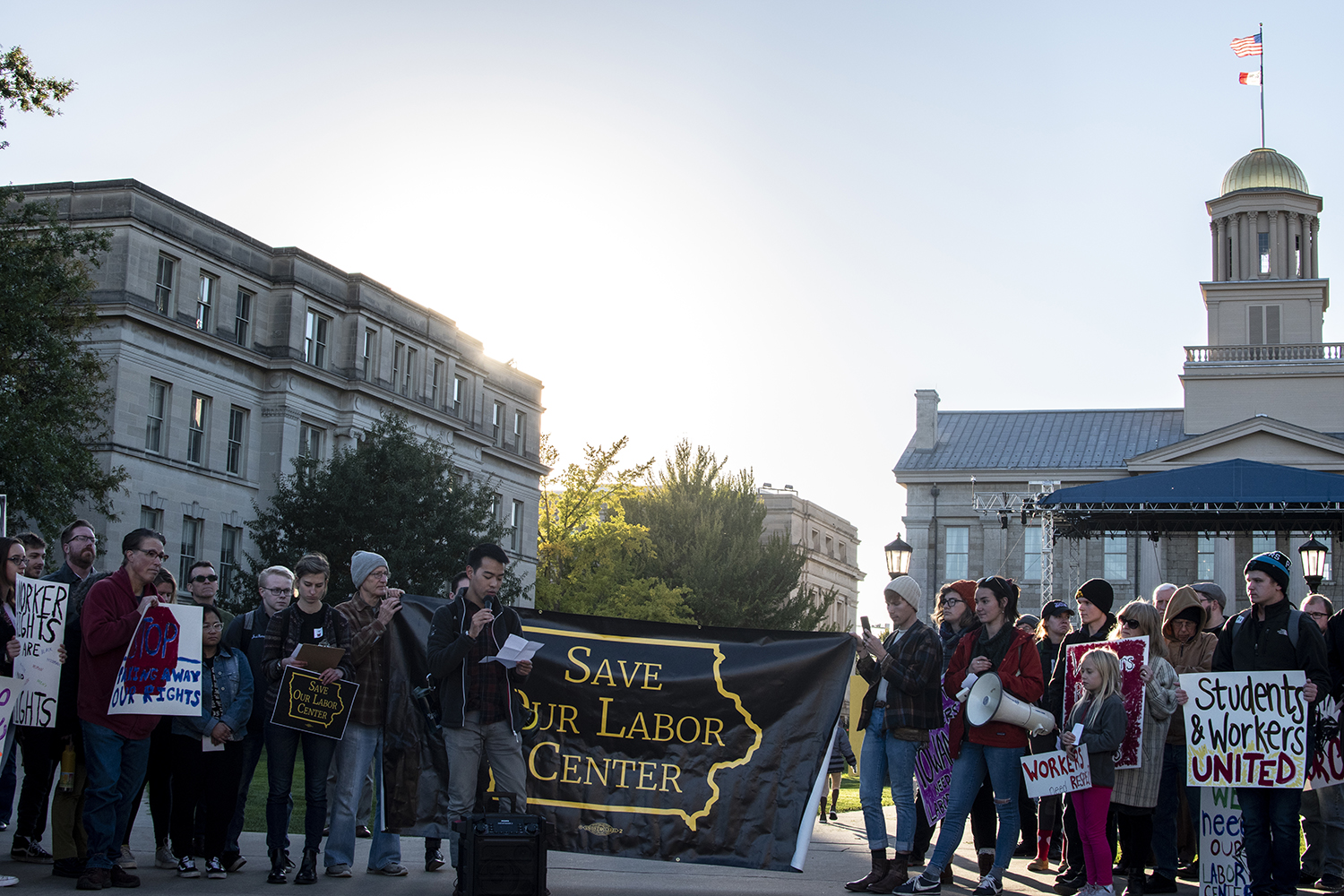 Community members gather on the Pentacrest to protest the closing of the Labor Center on Wednesday, Oct. 17, 2018.