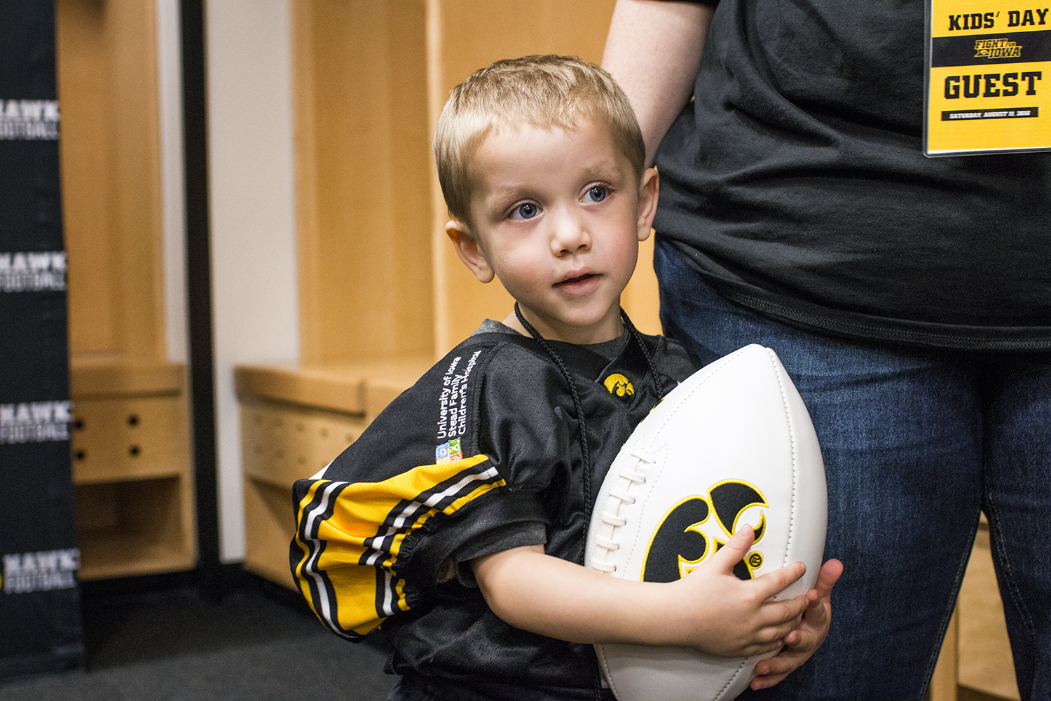 Kid Captain Mason Zabel holds a football during Iowa Football Kid's Day at Kinnick Stadium on Saturday, August 11, 2018. The 2018 Kid Captains met the Iowa football team and participated in a behind-the-scenes tour of Kinnick Stadium. Each child's story will be featured throughout the 2018 Iowa football season.